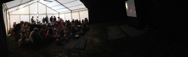 Audience in the cinema tent at Elderflower Fields